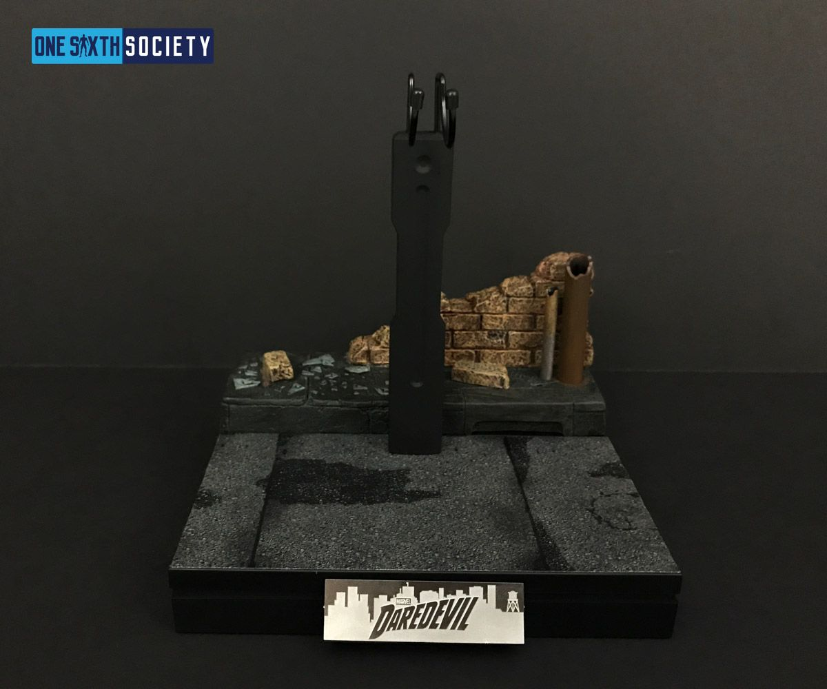 a Brick Diorama is included with the Hot Toys Daredevil Stand